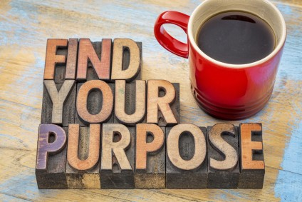 FInd your purpose - motivational phrase in vintage letterpress wood type blocks stained by color inks
