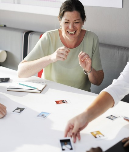 Collaborative leadership style: a team laughing around a table