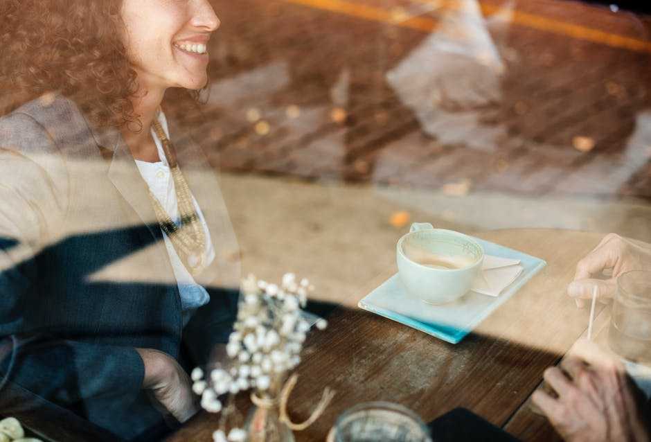 Culture: Woman laughing at coffee shop