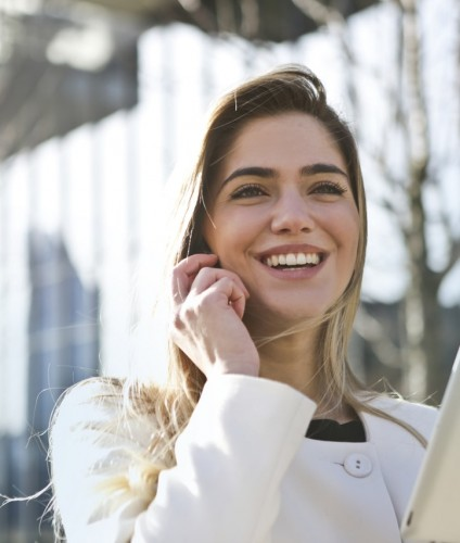 Good leader: Woman smiling on phone